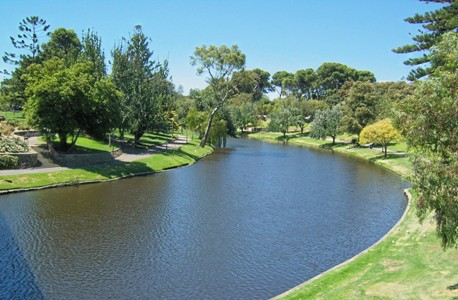 River Torrens curves gently within its green and grassy banks